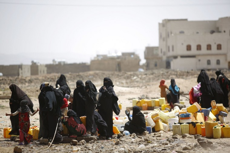 Women and children fill buckets with water from a public tap amid an acute shortage of water, on the outskirts of Sanaa, Yemen, Tuesday, Oct. 13, 2015. The war has taken a heavy toll on Yemen. More than 4,000 people have been killed, and the humanitarian crisis has left the impoverished country on the brink of famine. (AP Photo/Hani Mohammed)