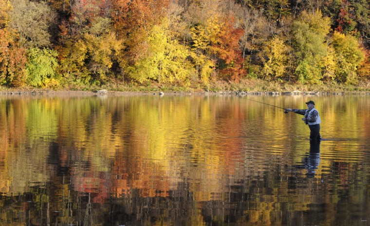 Gary Szilagyi casts his line while standing in the Susquehanna River where it meets with Fishing Creek, Monday, Oct. 26, 2015, in Bloomsburg, Pa. (Jimmy May/Bloomsburg Press Enterprise via AP)
