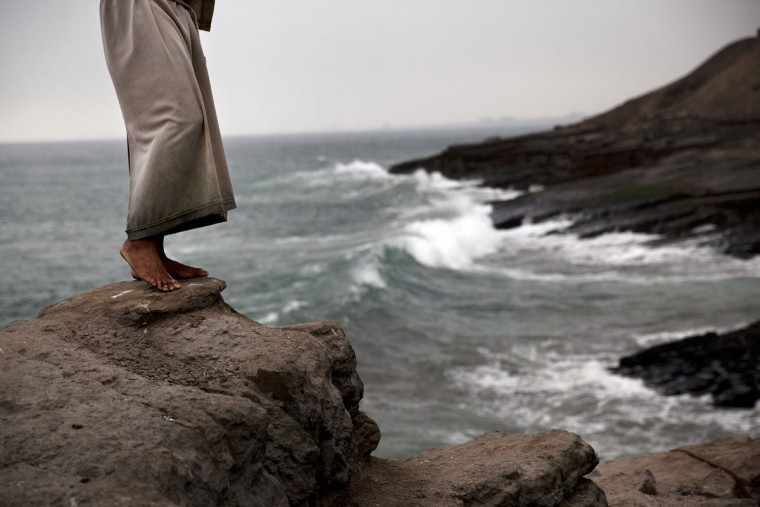 "A performer who reenacts the Monk's Dive or ""El Salto del Fraile,"" prepares to jump into the Pacific Ocean for clients dining at the restaurant of the same name, in the Chorillos district of Lima, Peru, Wednesday, Oct. 14, 2015. The performer dives daily for tourists and visitors reenacting the legend of the diving monk, who as legend goes, jumped to his death off these neighboring cliffs in despair over an unrequited love. (AP Photo/Rodrigo Abd)"