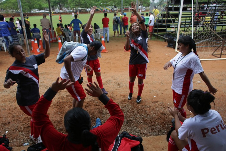 Indigenous female players from Peru dance before their soccer game with Canada at the World Indigenous Games in Palmas, Brazil, Wednesday, Oct. 28, 2015. (AP Photo/Eraldo Peres)