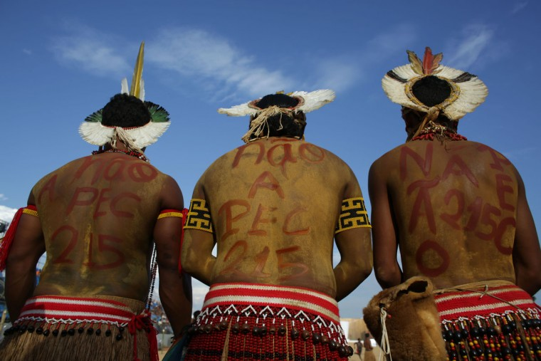 Brazilian Pataxos Indians with their bodies painted, hold a protest against the proposed amendment to the Brazilian constitution that would change the rules of demarcation of indigenous lands, during the World Indigenous Games, in Palmas, Brazil, Monday, Oct. 26, 2015. (AP Photo/Eraldo Peres)
