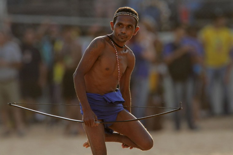 A participant from Philippines takes part in the bow and arrow competition at the World Indigenous Games, in Palmas, Brazil, Monday, Oct. 26, 2015. (AP Photo/Eraldo Peres)
