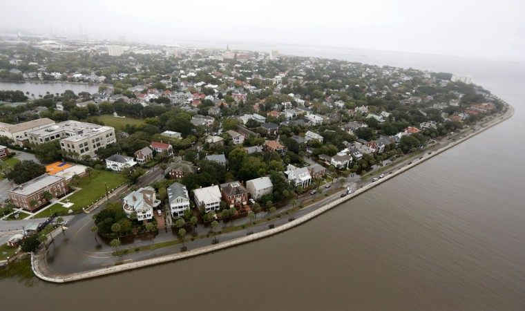 Overall aerial view shows historic Charleston at the Battery with minor flooding still visible in Charleston, S.C., Monday, Oct. 5, 2015. The Charleston and surrounding areas are still struggling with flood waters due to a slow moving storm system. (AP Photo/Mic Smith)