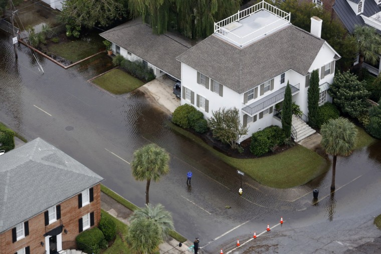 Parts of historic Charleston homes sit in floodwater in Charleston, S.C., Monday, Oct. 5, 2015. The Charleston and surrounding areas are still struggling with flood waters due to a slow moving storm system. (AP Photo/Mic Smith)