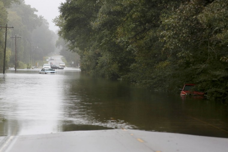 A vehicle is stranded on Hwy. 41 due to flood waters near Huger, S.C., Monday, Oct. 5, 2015. South Carolina is still struggling with flood waters due to a slow moving storm system. (AP Photo/Mic Smith)