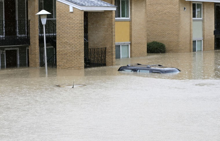 Flood waters engulf cars at an apartment complex in Columbia, S.C., Sunday, Oct. 4, 2015. The rainstorm drenching the U.S. East Coast brought more misery Sunday to South Carolina, cutting power to thousands, forcing hundreds of water rescues and closing many roads because of floodwaters. (AP Photo/Chuck Burton)