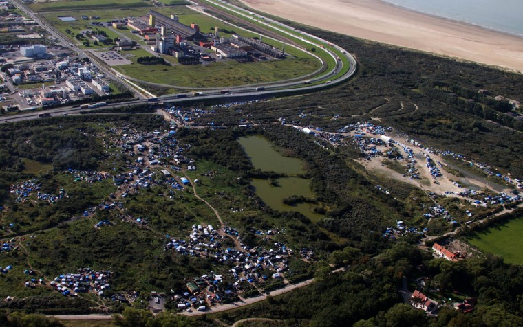 An aerial view of the migrant camp known as the New Jungle Camp, near to Calais, northern France, Friday, Sept. 25, 2015, with the English Channel in right, and a part of the city of Calais. (AP Photo/Michel Spingler)