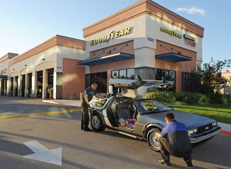 A replica DeLorean time machine makes a pit stop at a local Goodyear dealer for a full checkup before its big day on Tuesday, Oct. 20, 2015 in Lakewood, CA. Goodyear Eagle tires were used on the original car in the Back to the Future trilogy, which famously travelled forward in time to October 21, 2015. (Carlos Delgado/AP Images for Goodyear)