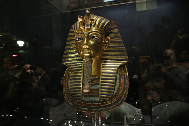 In this Saturday, Jan. 24, 2015, file photo, the gold mask of King Tutankhamun is seen in its glass case during a press tour, in the Egyptian Museum near Tahrir Square, Cairo, Egypt. An Egyptian official says the Antiquities Ministry gave an initial approval for the use of non-invasive radar to verify a theory that Queen Nefertiti's crypt may be hidden behind King Tutankhamun's 3,300-year-old tomb in the famous Valley of the Kings. (AP Photo/Hassan Ammar, File)