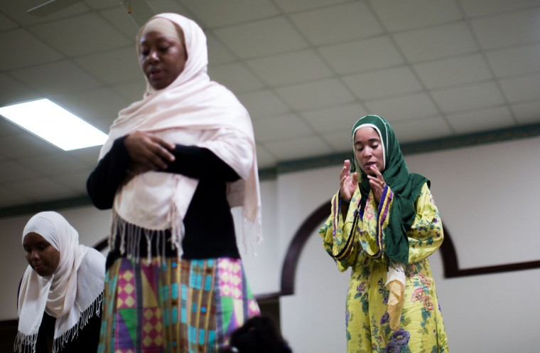 Yaqutullah Ibraheem Muhammad, right, Shahidah Sharif, center, and an unidentified woman pray together during Sunday prayers at the Atlanta Masjid of Al Islam mosque in Atlanta. Members of the mosque gathered to celebrate a group of pilgrims who will make the annual hajj pilgrimage to the holy city of Mecca. (AP Photo/Branden Camp)