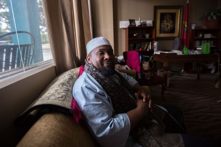 Imam Suleimaan Hamed, who will be leading a group on a Hajj pilgrimage to the holy city of Mecca, poses for a portrait at the Atlanta Masjid of Al Islam mosque, Sunday, Aug. 30, 2015, in Atlanta. Members of the mosque gathered to celebrate a group of pilgrims who will make the annual Hajj pilgrimage to the holy city of Mecca. (AP Photo/Branden Camp)