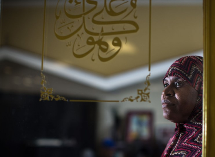 Jamilah Jihad, who will makie her Hajj pilgrimage to the holy city of Mecca, poses for a portrait at the Atlanta Masjid of Al Islam mosque , Sunday, Aug. 30, 2015, in Atlanta. Members of the mosque gathered to celebrate a group of pilgrims who will make the annual Hajj pilgrimage to the holy city of Mecca. (AP Photo/Branden Camp)