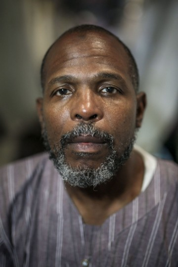 American Muslim pilgrim Khalifa Abdul-Wali, 54, poses for a picture outside his tent in Mina, outside the holy city of Mecca, Saudi Arabia. (AP Photo/Mosa'ab Elshamy)