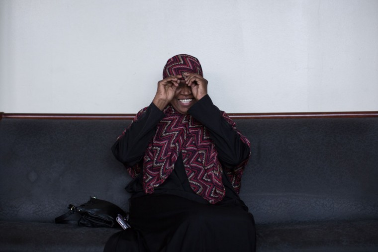 Jamilah Jihad, who will be making her Hajj pilgrimage to the holy city of Mecca, adjusts her scarf at the Atlanta Masjid of Al Islam mosque , Sunday, Aug. 30, 2015, in Atlanta. Members of the mosque gathered to celebrate a group of pilgrims who will make the annual Hajj pilgrimage to the holy city of Mecca. (AP Photo/Branden Camp)