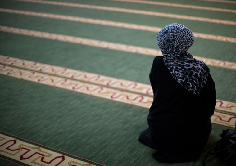 Semeera Hassen prays during Sunday prayers at the Atlanta Masjid of Al Islam mosque, Aug. 30, 2015, in Atlanta. Members of the mosque gathered to celebrate a group of pilgrims who will make the annual Hajj pilgrimage to the holy city of Mecca. (AP Photo/Branden Camp)
