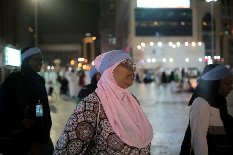 Zainab Nasir, 59, from Oakland, Calif. walks outside the grand mosque on her way to circle the Kaaba, the cubic building at the Grand Mosque in the Muslim holy city of Mecca, Saudi Arabia. (AP Photo/Mosa'ab Elshamy)