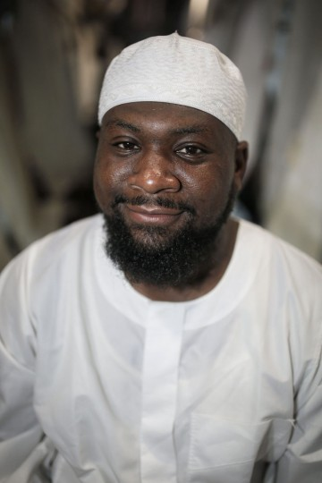Suleimaan Hamed, 35, CEO of Hajj Pros and Imam of Atlanta Masjid, poses for a picture outside his tent in Mina, outside the holy city of Mecca, Saudi Arabia. ìPack your patience, and wear it,î Hamed always tells the Americans he guides on hajj. Patience is key to dealing with the hajj crowds. Another piece of advice: ìTake off your American glasses.î (AP Photo/Mosa'ab Elshamy)