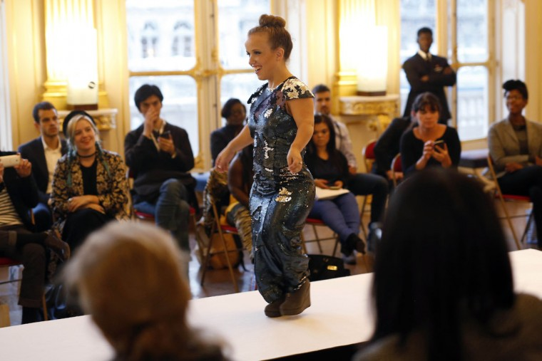 A model hits the catwalk at the French Ministry of Culture during the dwarf fashion show in Paris, France, Friday Oct. 2, 2015. The dwarf fashion show is an event organizers say is aimed at highlighting the elitism and prejudice that the model industry encourages in its depiction of bodies. It is presented during the Paris Fashion Week but is not part of it. (AP Photo/Jerome Delay)