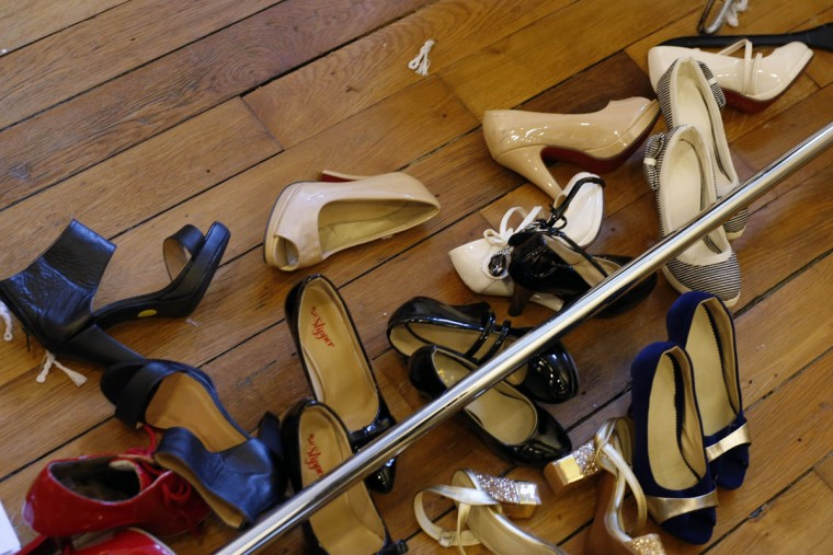 Shoes lay on the ground as models get ready before hitting the catwalk at the French Ministry of Culture during the dwarf fashion show in Paris, France, Friday Oct. 2, 2015. The show is an event organizers say is aimed at highlighting the elitism and prejudice that the model industry encourages in its depiction of bodies. It is presented during the Paris Fashion Week but is not part of it. (AP Photo/Jerome Delay)
