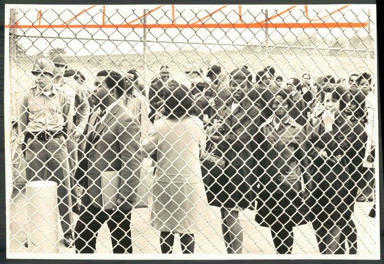 April 5, 1968 - BEHIND THE WIRE -- Bowie State College students arrested during a protest at the State House in Annapolis yesterday ended up behind this wire fence at the county jail. (Paul Hutchins/Baltimore Sun)