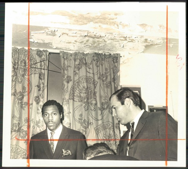 April 2, 1968 - BOWIE STATE -- Senator Julian Lapides (D. 2d Baltimore) scans dorm room as student guide, Calvin Reed, looks on. (Weyman Swagger/Baltimore Sun)