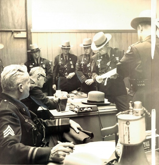 April 5, 1968 - CLASSROOM -- Two dozen State troopers led by Capt. Earl W. Reith, at desk, occupied Bowie State College today after moving students out as ordered by the Governor. (Clarence B. Garrett/Baltimore Sun)