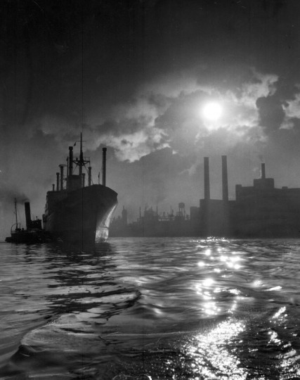 1955 - Bow Canada from Oslo in the upper Patapsco Basin Sugar Refinery and Procter and Gamble in background. (A. Aubrey Bodine/Baltimore Sun)