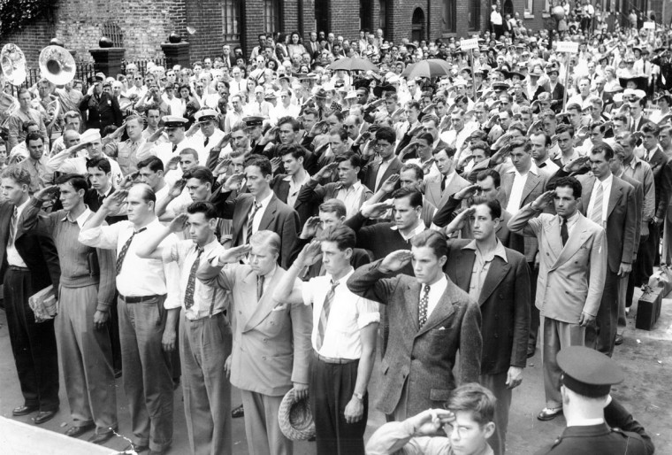 Naval recruits salute after taking the oath at the Flag House during the playing of the National Anthem. (Baltimore Sun photo, June 8, 1942)