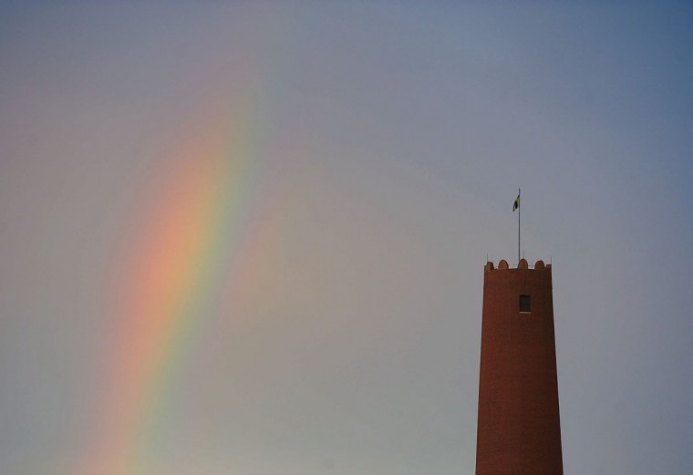 A portion of a rainbow rises behind the Shot Tower on June 28, 2013. (Karl Merton Ferron/Baltimore Sun Staff)