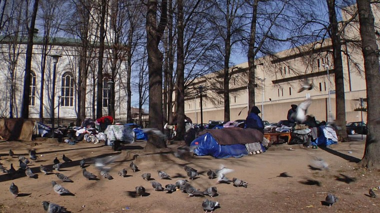 Pigeons and homeless congregate in front of St. Vincent de Paul Catholic Church on Feb. 7, 2007. (Baltimore Sun Staff / Karl Merton Ferron)