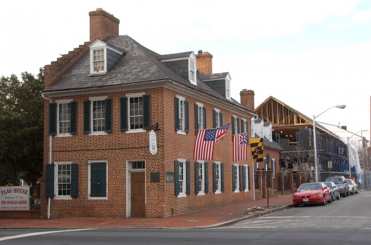The Star Spangled-Banner Flag House located at 844 East Pratt Street is pictured in December 2002. Behind the Flag House is the new Star-Spangled Banner Museum, which is under construction. (Baltimore Sun photo by Lloyd Fox)