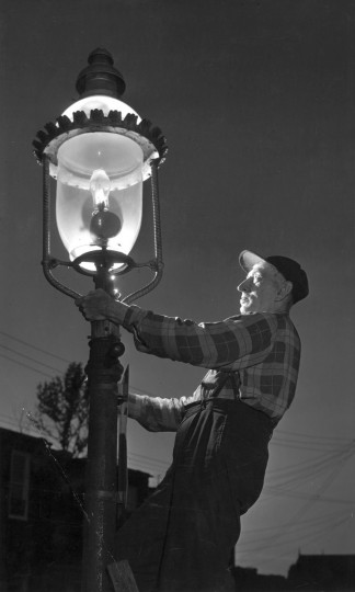 1957 - Willia Hoffman, the last lamplighter, 49 years of service. (A. Aubrey Bodine/Baltimore Sun)