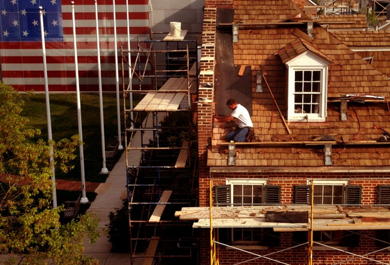 Roofer Tom Constine of York, Pa., works on the roof of the Flag House, which was the home of Mary Pickersgill and the site where she sewed the Star Spangled Banner garrison flag she made for Ft. McHenry. (Baltimore Sun photo by Jed Kirschbaum, April 21, 2006)
