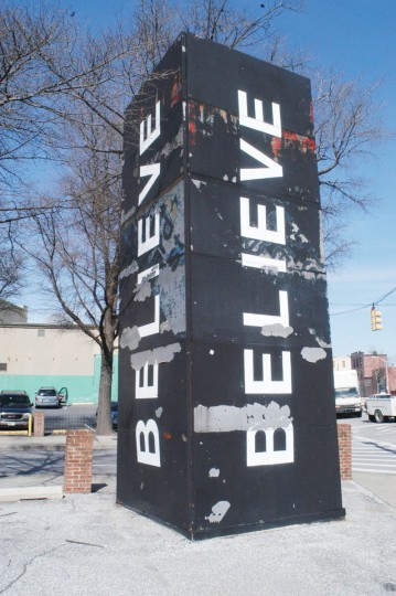 This pillar, at Lombard and Central, used to promote Corned Beef row. Then, under Martin O'Malley, it was repainted to say BELIEVE. With that paint job wearing off, the city has repainted it again. (Baltimore Sun photo)