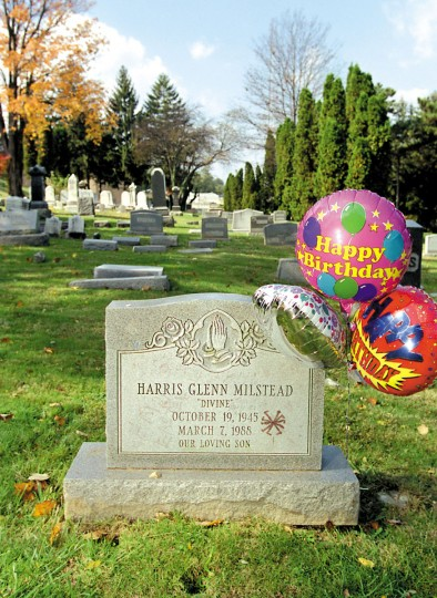 "Balloons adorn the headstone of Harris Glenn Milstead, better known as ""Divine"", on what would be his fifty-fifth birthday. The Lutherville-born actor is buried in Towson's Prospect Hill Cemetery. (Sam Friedman/Baltimore Sun, 2000)"