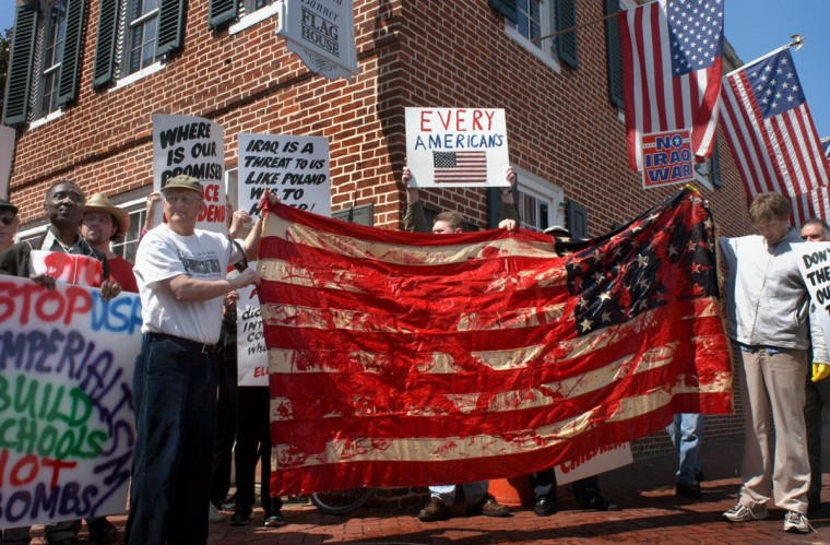 "The Baltimore Coalition to End War and Terrorism held a ""flag washing"" to symbolically clean off blood and oil from the U.S. flag at the historic Star Spangled Banner Flag House on March 22, 2003. (Baltimore Sun photo by Chiaki Kawajiri)"