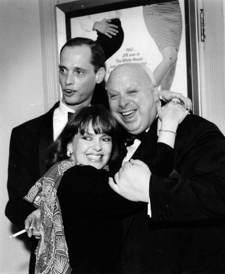 "February 16, 1988--World premiere of John Waters' new movie, ""Hairspray,"" at the Senator Theatre. (LtoR) John Waters, Pat Moran, and Divine, in front of poster for movie. (Amy Davis/Baltimore Sun)"
