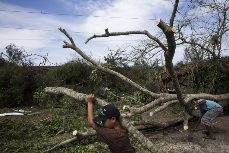 Residents of the Chamela community clear the debris left by Hurricane Patricia in the state of Jalisco, Mexico on October 24, 2015. Patricia flattened dozens of homes on Mexico's Pacific coast, but authorities said Saturday the record-breaking hurricane largely spared the country as it weakened to a tropical depression. (Hector Guerrero/AFP-Getty Images)