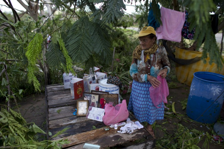 Maria del Refugio Ruiz Bravo sets out to dry personal belongings soaked by Hurricane Patricia, in La Fortuna, Mexico, Saturday, Oct. 24, 2015. Record-breaking Patricia pushed rapidly inland over mountainous western Mexico early Saturday, weakening to tropical storm force while dumping torrential rains that authorities warned could cause deadly floods and mudslides. (Rebecca Blackwell/Associated Press)