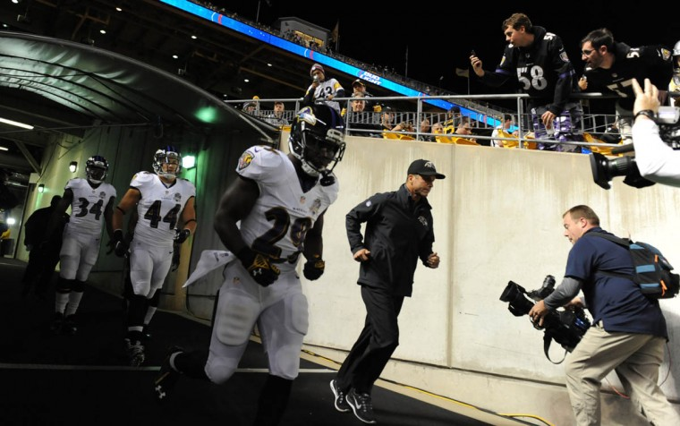 Baltimore Ravens head coach John Harbaugh (right) along with running back Justin Forsett (29) entering the field during pregame warmups prior to the Ravens game against the Steelers at Heinz Field in Pittsburgh. (Kenneth K. Lam/Baltimore Sun)
