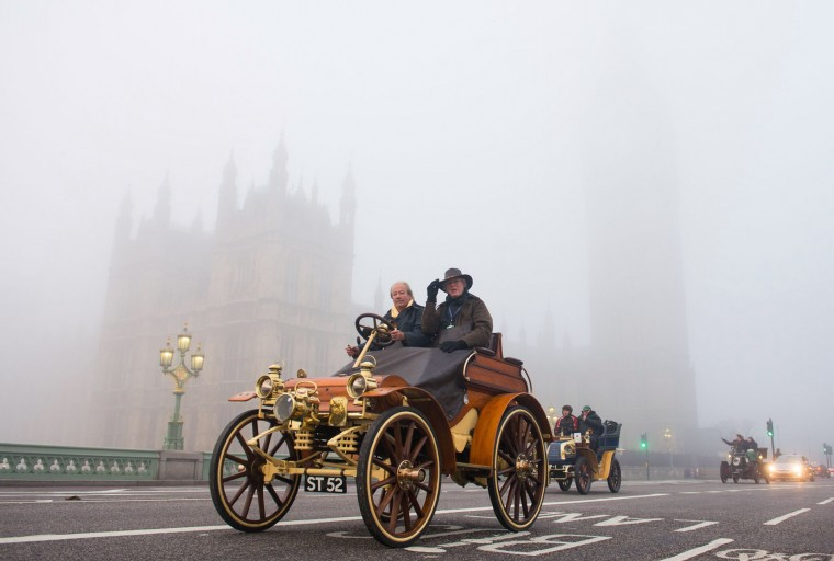 Participants in the London to Brighton Veteran Car Run, cross Westminster Bridge in London, with the houses of parliament partially seen through the morning fog, in London, Sunday Nov. 1, 2015. The London to Brighton Veteran Car Run is a long running traditional event only cars built before January 1, 1905, eligible to take part in the 54 miles (87 km) route, watched by thousands of onlookers. (Dominic Lipinski / PA via AP)