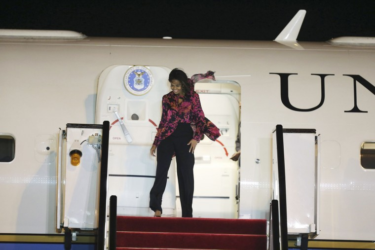 U.S. First Lady Michelle Obama arrives at the Hamad Airport in Doha, Qatar, Monday, Nov. 2, 2015. She'll visit the al-Udeid air base with comedian Conan O'Brien. She is also scheduled to give a speech Wednesday on her Let Girls Learn initiative at the 2015 World Innovation Summit for Education, sponsored by the Qatar Foundation. (AP Photo/Osama Faisal)