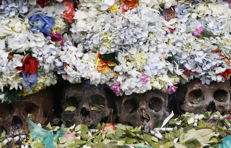 "Human skulls or ""natitas"" crowned with flowers are surrounded by offerings of coca leaves, flower petals and cigarettes, outside the Cementerio General chapel during the Natitas Festival, in La Paz, Bolivia, Sunday, Nov. 8, 2015. Although some natitas have been handed down through generations, many are from unnamed, abandoned graves that are cared for and decorated by faithful who use them as amulets believing they serve as protection. The tradition marks the end of the Catholic All Saints holiday, but is not recognized by the Catholic church. (AP Photo/Juan Karita)"