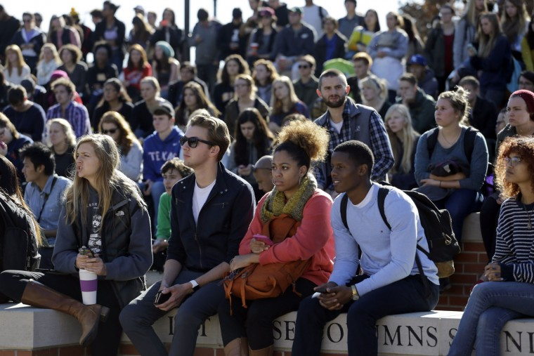 Students gather following the announcement University of Missouri System President Tim Wolfe would resign Monday, Nov. 9, 2015, at the University of Missouri in Columbia, Mo. (AP Photo/Jeff Roberson)