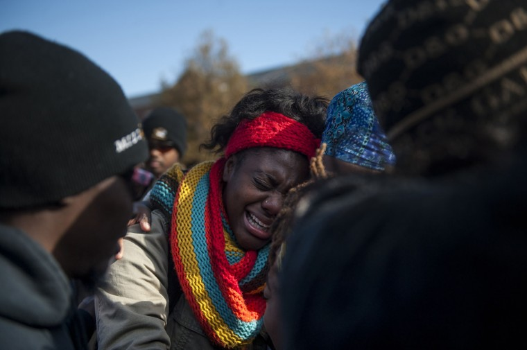 Protesters cry and hold each other after hearing news of UM System President Tim Wolfe's resignation during the Concerned Students 1950 protest on Monday, Nov. 9 2015, in Columbia, Mo. (Michael Cali/San Diego Union-Tribune/TNS)