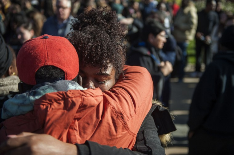 Concerned Students 1950 protesters hug each other and cry following news of Tim Wolfe's resignation during the Concerned Students 1950 protest on Monday, Nov. 9 2015, in Columbia, Mo. (Michael Cali/San Diego Union-Tribune/TNS)
