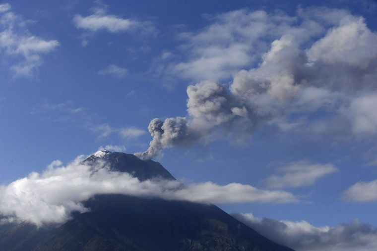 Tungurahua volcano spews ash and vapor, as seen seen Ojos del Volcan, Ecuador, Thursday, Nov. 19, 2015. Volcano monitors say about a dozen farming villages have been dusted with ash due to bursts from Ecuador''s Tungurahua volcano. Thursday''s report comes a day after authorities imposed new precautionary measures around the volcano, which has been increasingly restive. (AP Photo/Dolores Ochoa)