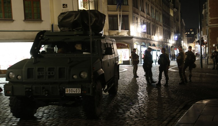 A Belgian armoured car waits outside a hotel, as soldiers stand guard in central Brussels, Monday, Nov. 23, 2015. The Belgian capital Brussels has entered its third day of lockdown, with schools and underground transport shut and more than 1,000 security personnel deployed across the country. (AP Photo/Alastair Grant)