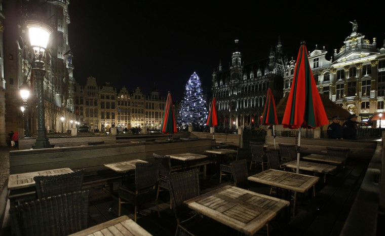 Empty tables are seen at a restaurant on the Grand Place in Brussels, Monday, Nov. 23, 2015. The Belgian capital Brussels has entered its third day of lockdown, with schools and underground transport shut and more than 1,000 security personnel deployed across the country. (AP Photo/Alastair Grant)