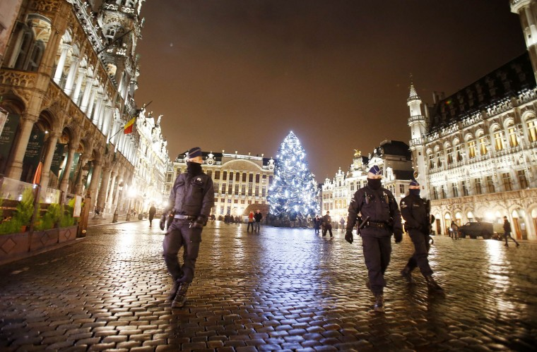 Belgian police officers patrol the Grand Place in downtown Brussels, Belgium, Monday, Nov. 23, 2015. The Belgian capital Brussels has entered its third day of lockdown, with schools and underground transport shut and more than 1,000 security personnel deployed across the country. (AP Photo/Michael Probst)